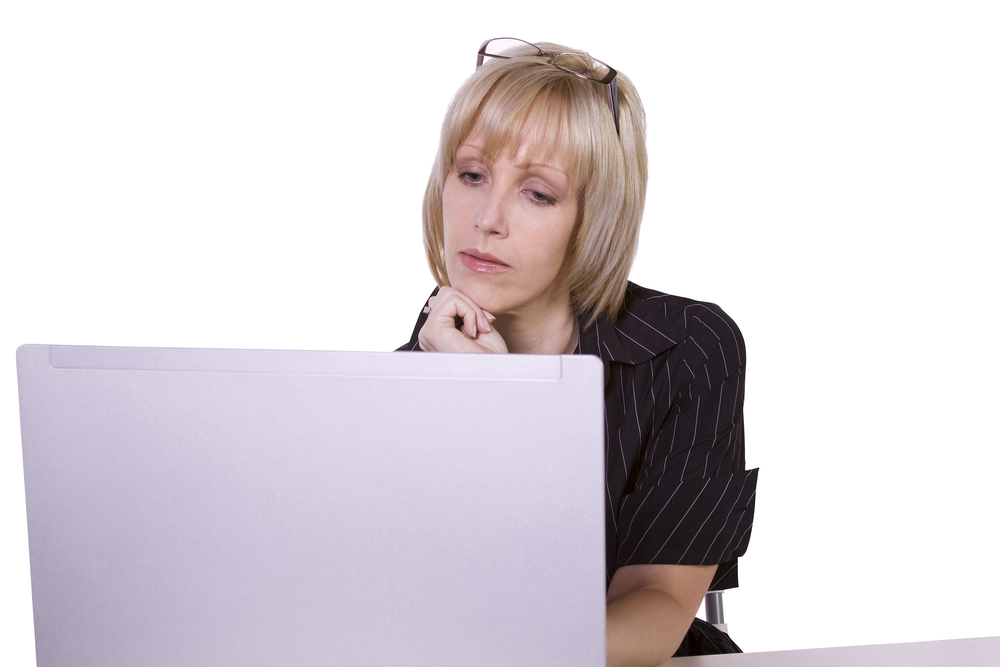 woman contemplating at computer